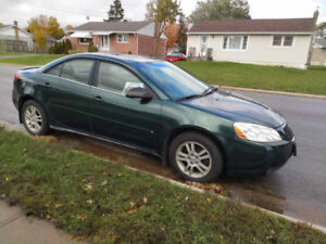 2006 green Pontiac G6 being sold by original owner.
