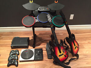 XBox 360 (including Rockband drum and 2 guitars + 24 games)
