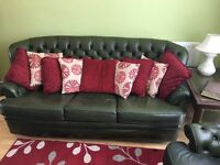 Green 3 seater Chesterfield and 2 armchairs.