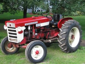 IH 240 Utility Tractor with 2 Attachments