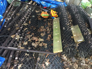 Brown chain link fence/poles/cement holder