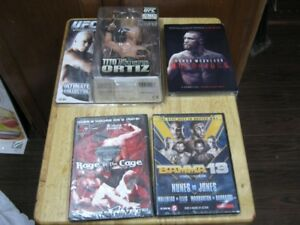 3 mma dvd's and ufc tito ortiz figure. all 4 pcs. .$25  firm