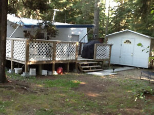 2003 Tahoe 31ft trailer and lot at Whispering Spruce