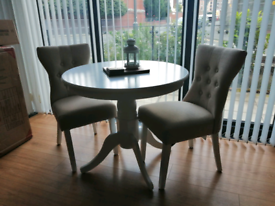 White Wood Round Table & 2 Pale Beige Chairs.