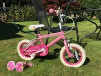 Beautiful pink child's bike, with stabilisers.