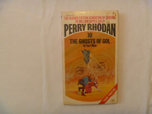 pile of 4 PERRY RHODAN paperbacks