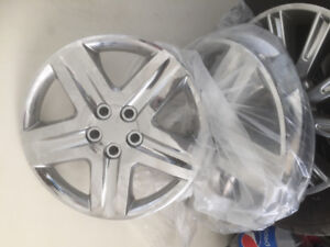 4 NEW HUBCAPS OFF A 2014 CAMARY