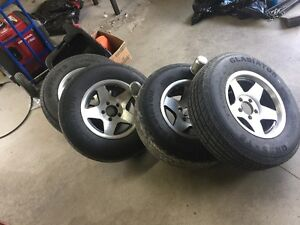Four Aluninum Trailer Rims 5 on 4 1/2 With 2X 3500 LB Axels