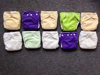 10 FuzzyBunz cloth diapers and liners