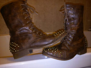 Leather spiked boots.