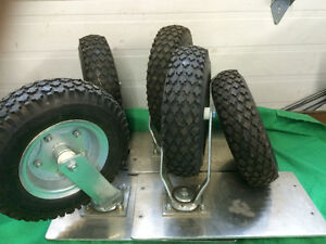 4 PNEUMATIC CASTERS PLUS SPARE WHEEL