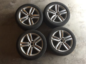 Gently used VW wheels and Continental all season tires