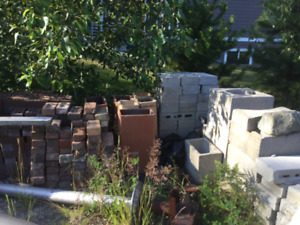 Misc bricks and lumber and garden hoses
