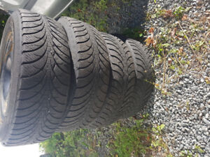 """17 """"Winter tires on steel rims 5 bolt pattern with hub caps"""
