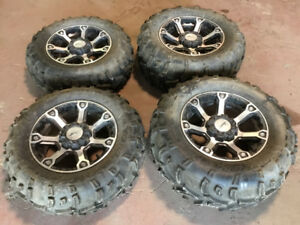 """Brand new 14"""" Arctic Cat wheels and tires"""
