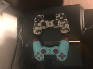 PS4 with controllers and games.