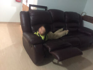 Recliner bed, one side reclines. For sale for only 300.00 firm