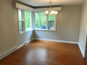Large 3 bedroom main floor unit w/ attached garage- Avail Nov.1