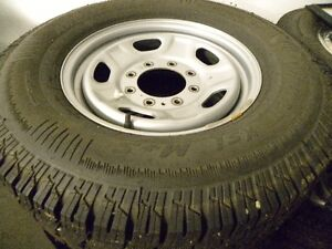STUDDED ARCTIC CLAW WINTER TIRES ON RIMS