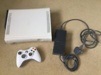 X box 360 console with controller