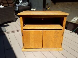 Oak TV stand on casters