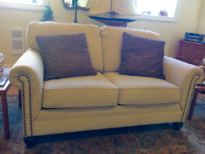 Like New - 'Ashley' Loveseat with brass tack  trim