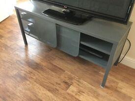TV unit with shelf and sliding doors
