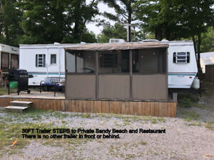 Newly Renovated Trailer on the water with private sandy Beach