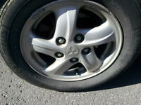 5 Michelin tires, 185 65 14 near new on Mags All season
