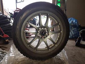 "Bridgestone Blizzaks on 17"" gunmetal grey rims, 15k on both London Ontario image 1"