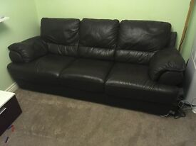 Real leather three seater sofa chocolate brown with matching pouffe.