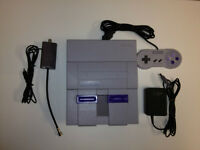 SUPER NINTENDO SYSTEM WITH A CONTROLLER AND GAME