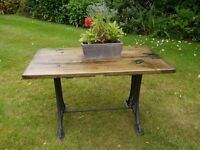 Industrial Side Table with a Cast Metal Base and Wood Top