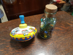 Vintage tin top and corked jar of marbles