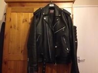 Genuine, barely worm leather biker jacket.