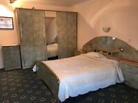 Full bedroom set; cupboard, chest draws, dressing table, mirror and bed