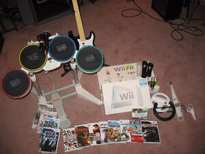 Nintendo Wii w/Rock Band and Wii Fit + games