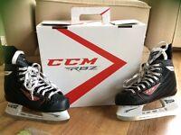 Girls size 4 ice hockey boots
