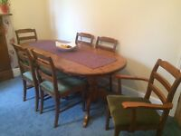 Solid pine dining table with 4 chairs and 2 carvers