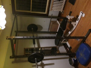 Power rack cage with Olympic bar bench and 2x45lb plates leg ext