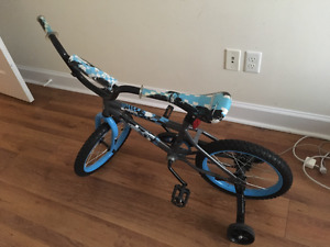 Blue bike with training wheels