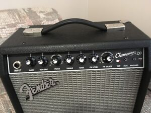 Fender Squire Strat Electric Guitar/Fender 20 Amp and Acc.