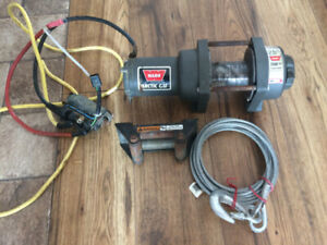 warn winch 2500lbs with new cable and mounting plate