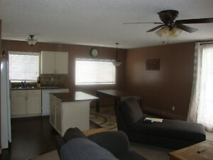 Large corner unit condo with 2 titled parking stalls!!!