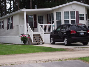 Looking to buy a mobile home in a nice area or park.