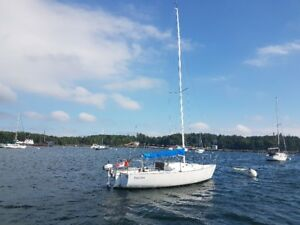 J24 sailboat with trailer
