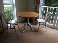 Stunning John Lewis oak dining table and two chairs