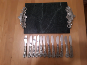 Green marble cheese cutting board with 12 pewter knives