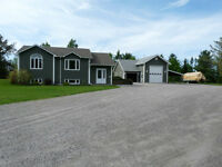 PRIVACY! 13.8 ACRES! BEAUTIFUL HOME & UPSCALE GARAGE!