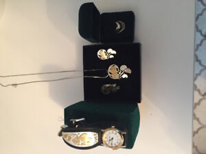 Matching watch, earrings and necklace.  Two rings for sale!